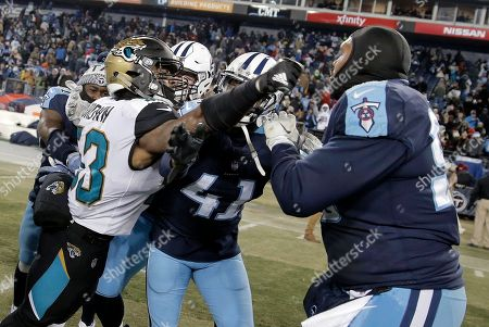 Blair Brown, Brynden Trawick, Jurrell Casey. Jacksonville Jaguars linebacker Blair Brown (53) swings at Tennessee Titans defensive end Jurrell Casey, right, as Titans defensive back Brynden Trawick (41) steps in during a scuffle after an NFL football game, in Nashville, Tenn. The Titans won 15-10