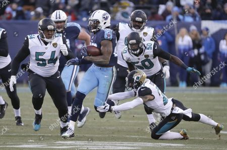 Derrick Henry, Eli Ankou, Telvin Smith, A J Bouye. Tennessee Titans running back Derrick Henry (22) gets past Jacksonville Jaguars defenders Eli Ankou (54), Telvin Smith (50) and A.J. Bouye (21) as Henry scores a touchdown on a 66-yard pass play in the first half of an NFL football game, in Nashville, Tenn