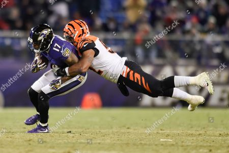 Mike Wallace, Brandon Bell. Baltimore Ravens wide receiver Mike Wallace (17) is stopped by Cincinnati Bengals linebacker Brandon Bell (52) during the second half of an NFL football game in Baltimore