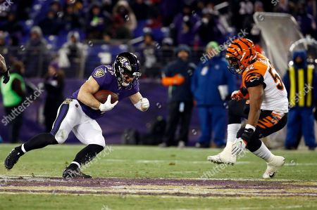 Brandon Bell, Danny Woodhead. Baltimore Ravens running back Danny Woodhead, left, rushes against Cincinnati Bengals linebacker Brandon Bell during the second half of an NFL football game in Baltimore