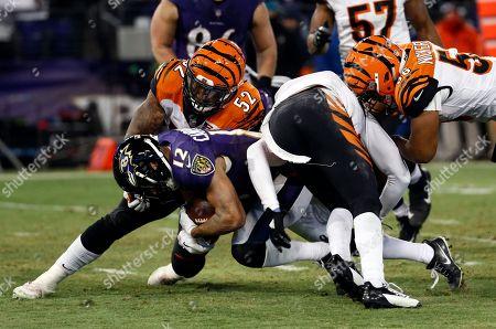 Michael Campanaro, Brandon Bell. Cincinnati Bengals linebacker Brandon Bell (52) tackles Baltimore Ravens wide receiver Michael Campanaro (12) during the second half of an NFL football game in Baltimore