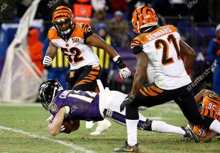 Darqueze Dennard, Brandon Bell, Michael Campanaro. Baltimore Ravens wide receiver Michael Campanaro (12) falls to the turf in front of Cincinnati Bengals linebacker Brandon Bell (52) and cornerback Darqueze Dennard (21) during the second half of an NFL football game in Baltimore