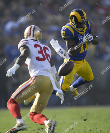 Los Angeles Rams wide receiver Tavon Austin can't catch a pass as San Francisco 49ers cornerback Dontae Johnson looks on during the first half of an NFL football game, in Los Angeles