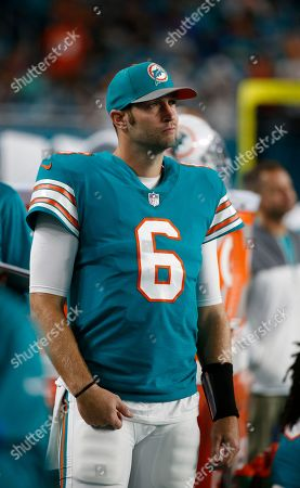 Miami Dolphins quarterback Jay Cutler (6) looks from the sidelines, during the first half of an NFL football game against the Buffalo Bills, in Miami Gardens, Fla