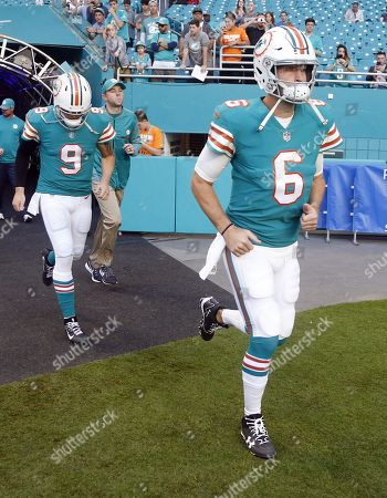 Jay Cutler, David Fales. Miami Dolphins quarterbacks Jay Cutler (6) and David Fales (9), enter the field before an NFL football game against the Buffalo Bills, in Miami Gardens, Fla