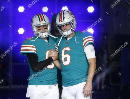 Jay Cutler, David Fales. Miami Dolphins quarterback Jay Cutler (6) and Miami Dolphins quarterback David Fales (9), greet each other before entering the field at an NFL football game against the Buffalo Bills, in Miami Gardens, Fla