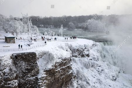 People visit the Niagara Falls during extreme cold weather as sub-zero temperatures are expected across Canada and the United States on New Year's Eve and New Year's day.