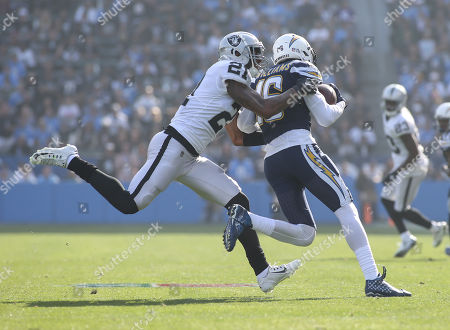 Carson, CA...Los Angeles Chargers wide receiver Tyrell Williams (16) being tackled by Oakland Raiders cornerback Sean Smith (21) during the NFL Oakland Raiders vs Los Angeles Chargers at the Stubhub Center in Carson, Ca on , 2017