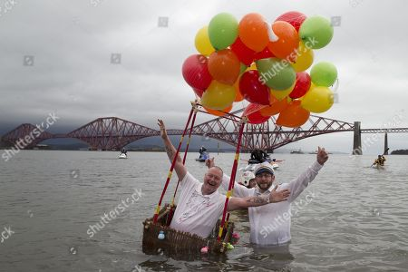 Loony Dook participants, Tony Pirouet, from Fife, and Kenny Smith, from Rosyth, in the River Forth at South Queensferry to celebrate New Year's Day and raise money for the RNLI.