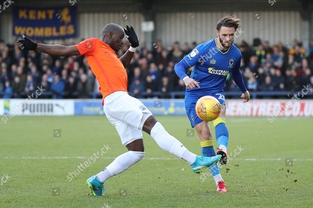 AFC Wimbledon defender Callum Kennedy (23) battles for possession with Southend United forward Marc-Antoine Fortune (9) during the EFL Sky Bet League 1 match between AFC Wimbledon and Southend United at the Cherry Red Records Stadium, Kingston