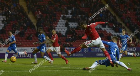 Leon Best of Charlton Athletic has a shot and injurys his left leg as he lands