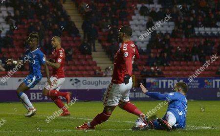 Leon Best of Charlton Athletic injury his left leg following a shot