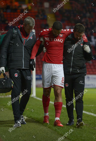 Leon Best of Charlton Athletic is helped off the pitch following an injury