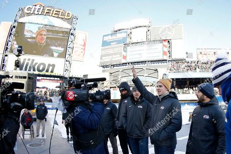 Troy Terry waves to the crowd as the roster for the men's USA Olympic hockey team is announced at the NHL Winter Classic hockey game between the Buffalo Sabres and the New York Rangers at CitiField in New York on
