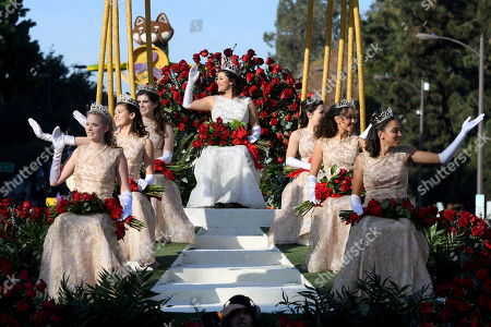 Rose Queen Isabella Marie Marez, top, and Princesses, clockwise from lower left, Georgia Jane Cervenka, Sydney Grace Pickering, Julianne Elise Lauenstein, Alexandra Marie Artura, Savannah Rose Bradley and Lauren Elizabeth Buehner ride on their float at the 129th Rose Parade in Pasadena, Calif