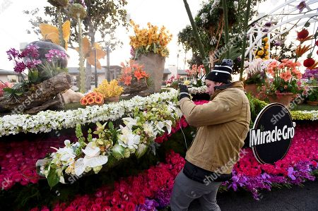 """DIY expert and TV personality Ty Pennington snaps a quick picture of all the details in Miracle-Gro's 2018 Rose Parade float, """"150 Years and Growing"""", on in Pasadena, Calif. This is the third year Pennington returns to ride Miracle-Gro entry in the Rose Parade"""