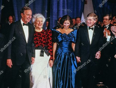 From left to right: United States President-elect George H.W. Bush, Barbara Bush, Marilyn Quayle, and US Vice President-elect Dan Quayle, attends the Inaugural Gala at the Washington DC Convention Center in Washington, DC.