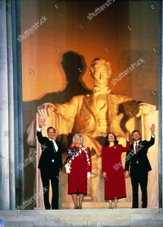 United States President-elect George H.W. Bush attends the opening ceremony for his inauguration at the Lincoln Memorial in Washington, DC. From left to right: President-elect Bush, Barbara Bush, Marilyn Quayle, and US Vice President-elect Dan Quayle.