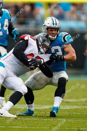 Luke Kuechly, Derrick Coleman. Carolina Panthers middle linebacker Luke Kuechly (59) works to tackle Atlanta Falcons fullback Derrick Coleman (40) during an NFL game in Charlotte, N.C. on