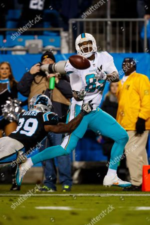 Miami Dolphins tight end Julius Thomas (89) works to make a catch against the Carolina Panthers during an NFL game in Charlotte, N.C. on
