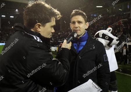 Former Fulham player Zoltan Gera on the pitch at halftime