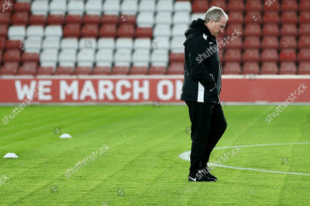 Crystal Palace Assistant Ray Lewington looks at the condition of the pitch before the match.