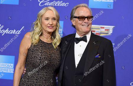 """Peter Fonda, Margaret DeVogelaere. Margaret """"Parky"""" DeVogelaere, left, and Peter Fonda arrive at the 29th annual Palm Springs International Film Festival, in Palm Springs, Calif"""