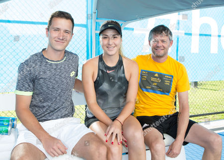 Belinda Bencic, trainer Ian Hughes and hitting partner Martin Blasko