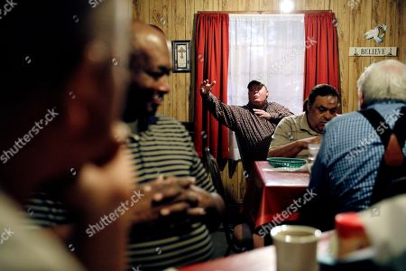 Stock Picture of Paul Franklin, rear, speaks at a prayer breakfast at a diner in Lumberton, N.C