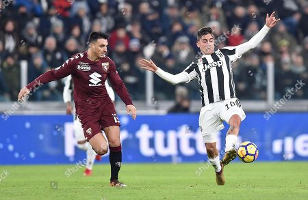 Juventus' Paulo Dybala (R) and Torino's Nicolas Burdisso in action during the Italy Cup quarter-final soccer match Juventus FC vs Torino FC at Allianz Stadium in Turin, Italy, 03 January 2018.
