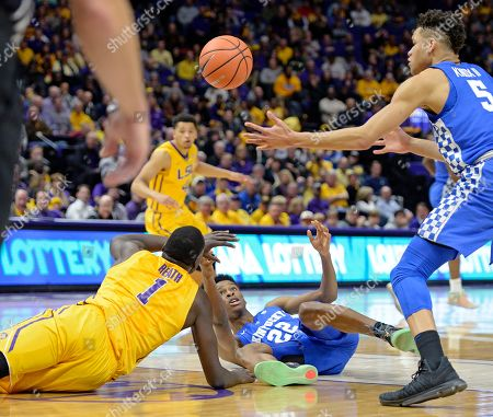Stock Picture of Kevin Knox, Duop Reath, Shai Gilgeous-Alexander. Kentucky forward Kevin Knox (5) and LSU forward Duop Reath (1) go after the loose ball as Kentucky guard Shai Gilgeous-Alexander (22) watches in the first half of an NCAA college basketball game, in Baton Rouge, La
