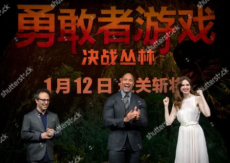 Dwayne Johnson, Karen Gillan, Jake Kasdan. From left, American director Jake Kasdan, American actor Dwayne Johnson, and British actress Karen Gillan laugh during a press conference for the movie 'Jumanji: Welcome to the Jungle' in Beijing, . The hit movie opens in China on Jan. 12