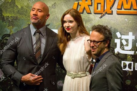 Dwayne Johnson, Karen Gillan, Jake Kasdan. From left, American actor Dwayne Johnson, British actress Karen Gillan, and American director Jake Kasdan pose for photos on the red carpet before a press conference for the movie 'Jumanji: Welcome to the Jungle' in Beijing, . The hit movie opens in China on Jan. 12