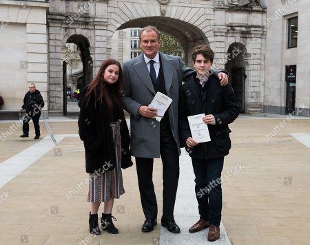 Stock Image of Hugh Bonneville attending the service with Madeleine Harris and Samuel Joslin.