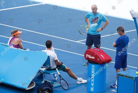 Roger Federer and Belinda Bencic of Team Switzerland with Coach Ivan Ljubicic and Ian Hughes