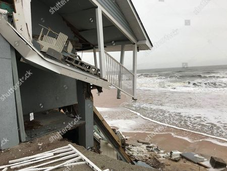 An unoccupied beachfront home collapses due to beach erosion in Ponte Vedra Beach, Fla. No one was injured. Several homes along the northeast Florida beaches collapsed during Hurricane Irma in September