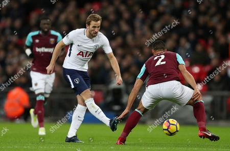 Harry Kane of Tottenham Hotspur and Winston Reid of West Ham United in action