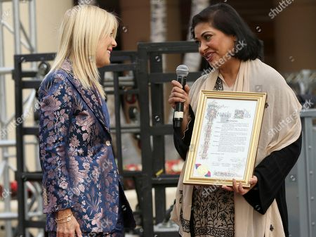 Lili Bosse, Meher Tatna. Mayor of Beverly Hills Lili Bosse,left, and Meher Tatna attend the 75th Annual Golden Globe Awards Preview Day at The Beverly Hilton, in Beverly Hills, Calif