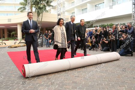 Seth Meyers, Meher Tatna, Allen Shapiro, Barry Adelman. Seth Meyers, from left, Meher Tatna, Allen Shapiro and Barry Adelman roll-up the red carpet at the 75th Annual Golden Globe Awards Preview Day at The Beverly Hilton, in Beverly Hills, Calif