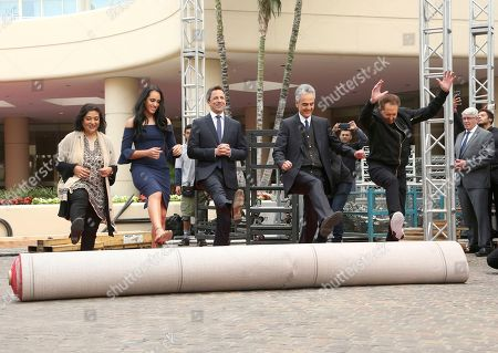 Seth Meyers, Simone Garcia Johnson, Meher Tatna, Allen Shapiro, Barry Adelman. Seth Meyers, from left, Simone Garcia Johnson, Meher Tatna, Allen Shapiro and Barry Adelman roll-up the red carpet at the 75th Annual Golden Globe Awards Preview Day at The Beverly Hilton, in Beverly Hills, Calif