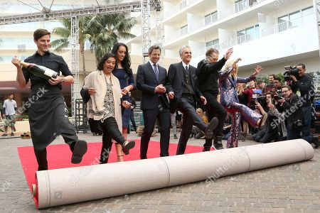 Seth Meyers, Simone Garcia Johnson, Meher Tatna, Allen Shapiro, Barry Adelman, Lili Bosse. Meher Tatna, from left, Simone Garcia Johnson, Seth Meyers, Allen Shapiro, Barry Adelman and Lili Bosse roll-up the red carpet at the 75th Annual Golden Globe Awards Preview Day at The Beverly Hilton, in Beverly Hills, Calif