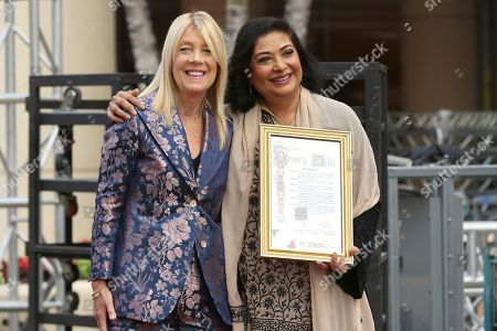 Lili Bosse, Meher Tatna. Beverly Hills Mayor Lili Bosse, left, and Meher Tatna attend the 75th Annual Golden Globe Awards Preview Day at The Beverly Hilton, in Beverly Hills, Calif