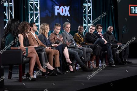 "Merrin Dungey, Melina Kanakaredes, Manish Dayal, Emily VanCamp, Matt Czuchry, Bruce Greenwood, Shaunette Renee Wilson, Todd Harthan, Amy Holden Jones, Antoine Fuqua. Merrin Dungey, from left, Melina Kanakaredes, Manish Dayal, Emily VanCamp, Matt Czuchry, Bruce Greenwood, Shaunette Renee Wilson, Todd Harthan, Amy Holden Jones and Antoine Fuqua participate in ""The Resident"" panel during the FOX Television Critics Association Winter Press Tour, in Pasadena,Calif"