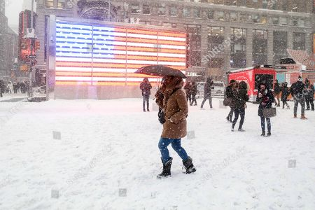 Times Square on a day when heavy snowfall hits Manhattan Island in New York