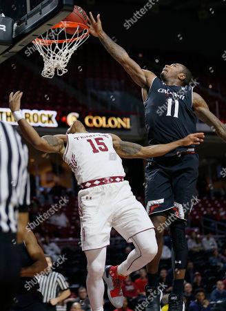 Nate Pierre-Louis, Gary Clark. Temple guard Nate Pierre-Louis (15) is fouled by Cincinnati forward Gary Clark (11) during the second half of an NCAA college basketball game, in Philadelphia. Cincinnati won 55-53