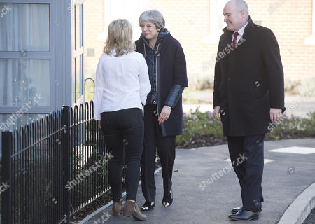 Prime Minister Theresa May meeting new home owner Laura Paine at the Montague Park housing estate in Wokingham. with Gary Ellis (Barrett Homes Regional Managing Director)