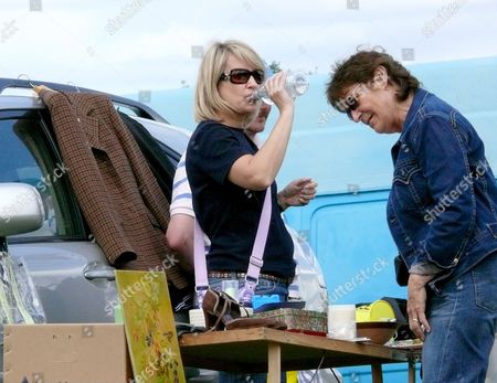 Nicki Chapman former judge on the X-Factor with her boyfriend sell goods at a car boot sale near Ripley