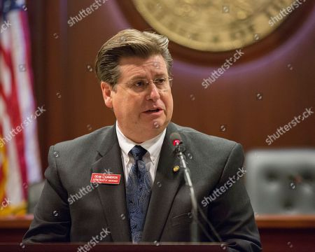 Stock Image of Idaho State Insurance Director Dean Cameron speaks to reporters about a health insurance executive order at the State Capitol building in Boise, Idaho
