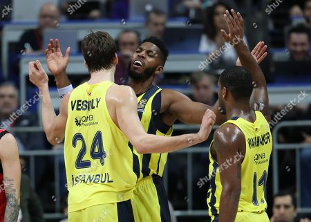 Fenerbahce Dogus' Jason Thompson (C) celebrates after scoring with team mates Jan Vesely (L) and Bradley Wanamaker (R) reacts during the Euroleague basketball match between Fenerbahce Dogus and Baskonia in Istanbul, Turkey 05 January 2018.