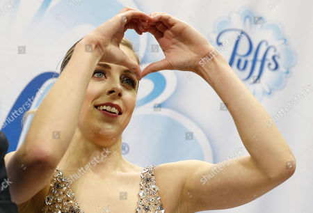 Ashley Wagner gestures while watching her scores during the women's free skate event at the U.S. Figure Skating Championships in San Jose, Calif